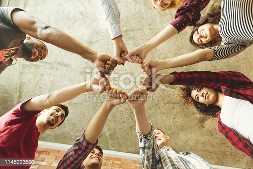Group of people making fist bump. People solidaruty concept