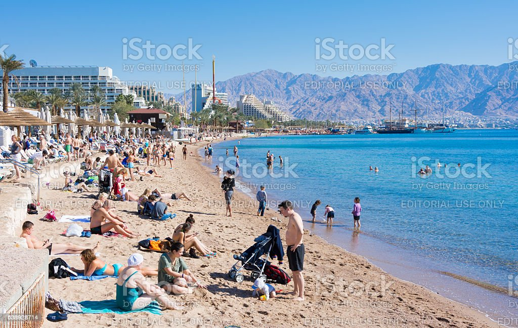 people spending christmas on the beach at eilat israel royalty free stock photo