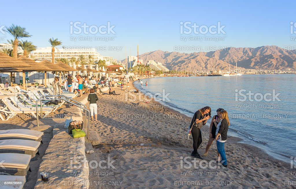 People spending Christmas on the beach at Eilat, Israel stock photo