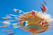 istock People Spinning on Carnival Swing Ride. Motion-Blur. 157640494