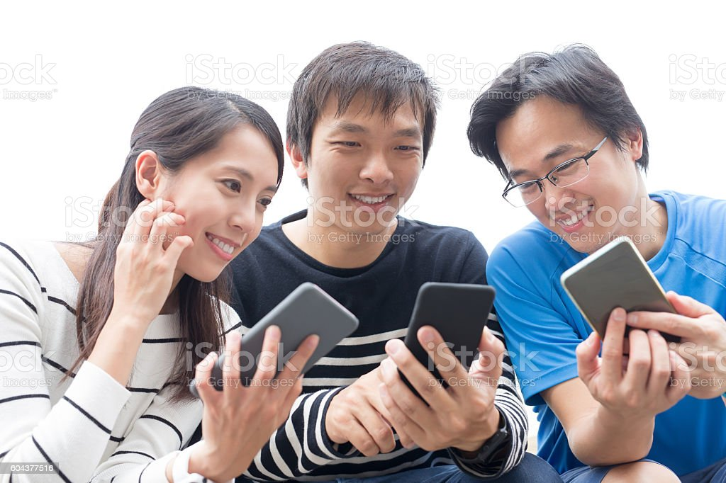 people stake smart phone together stock photo
