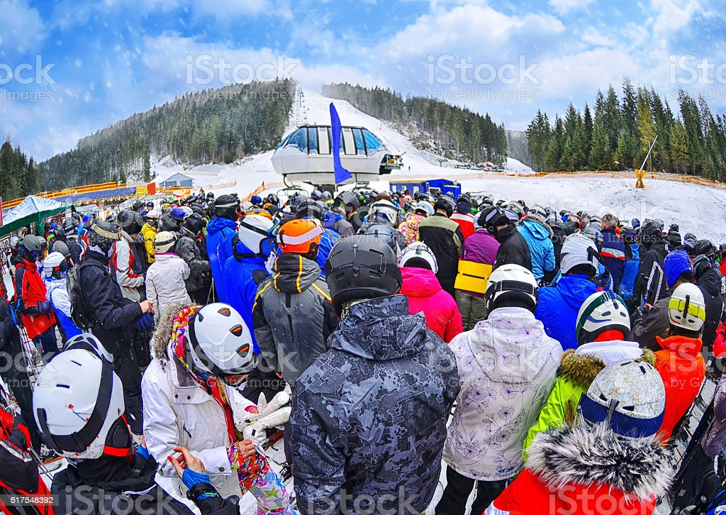 People stand before ski lift in queue in Bukovel stock photo