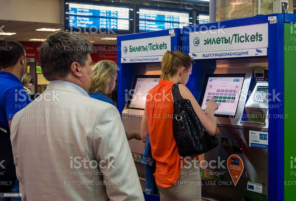 People stand in a queue to the terminals stock photo