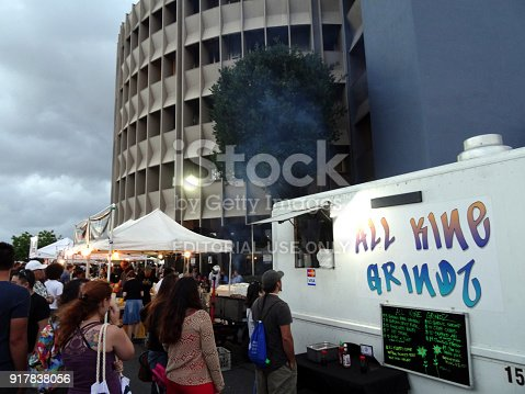 Honolulul - July 2, 2016: People stand in line for All Kine Grindz food truck at event in Honolulu, Hawaii.