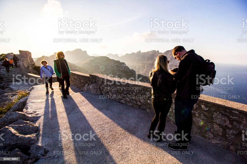 People Stand on Path at Cap de Formentor, in North Mallorca / Majorca stock photo