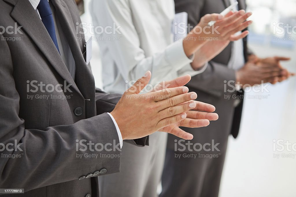 People standing and applauding royalty-free stock photo
