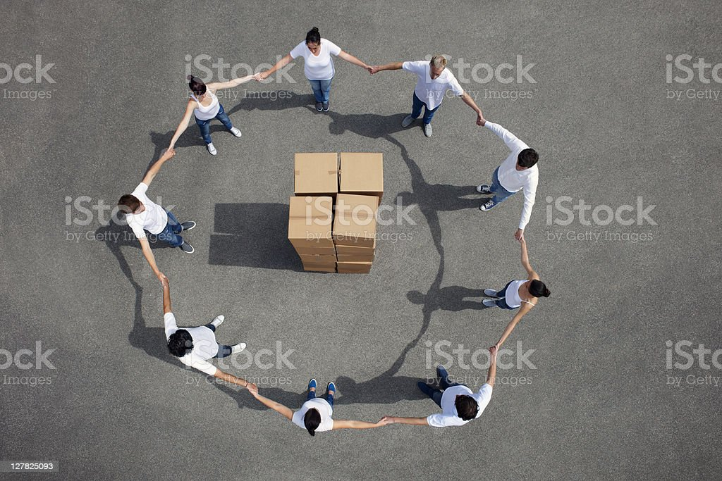 People standing around stacked boxes royalty-free stock photo