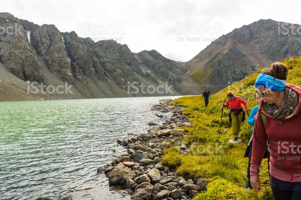 People standing at Alakol lake in Kyrgyzstan stock photo