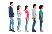 Multi Ethnic People Standing In A Row Isolated On White Background .