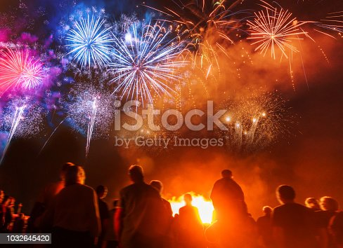 istock People standing in front of colorful Firework 1032645420