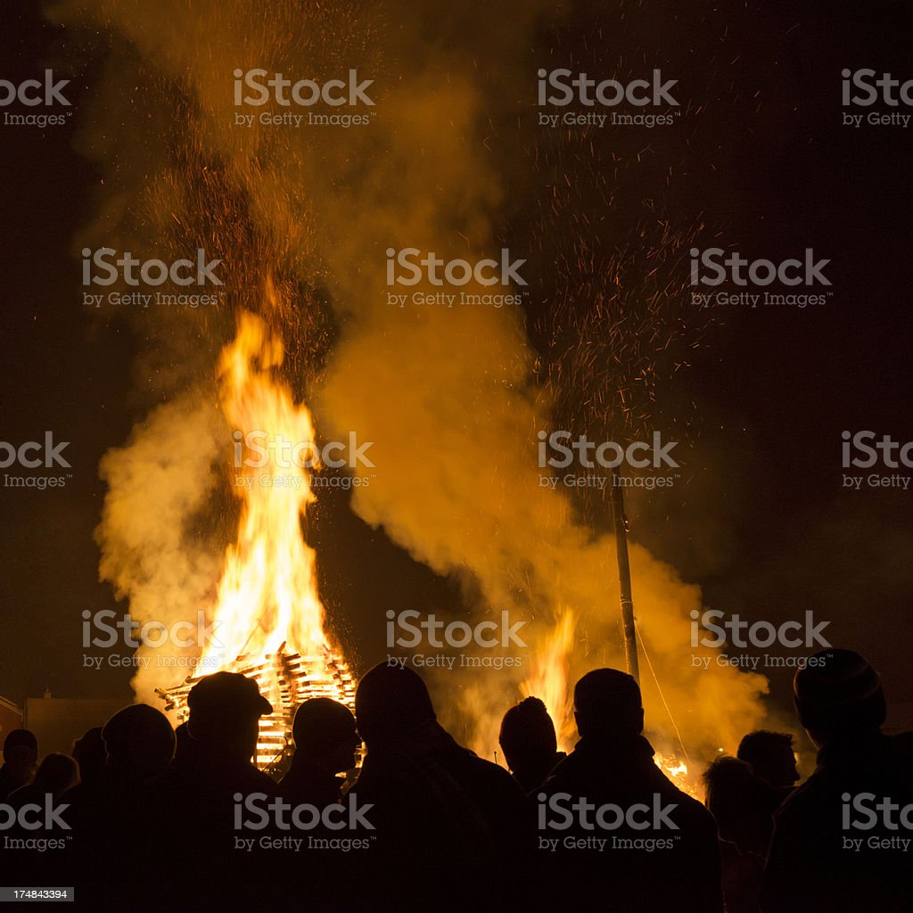 people standing in front of fire at night royalty-free stock photo