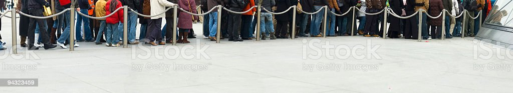 People standing in line stock photo