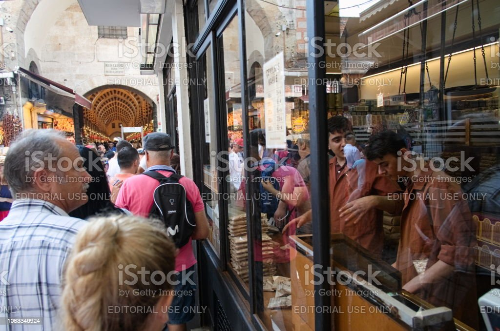 People standing in line to buy ground Turkish coffee in the coffee...