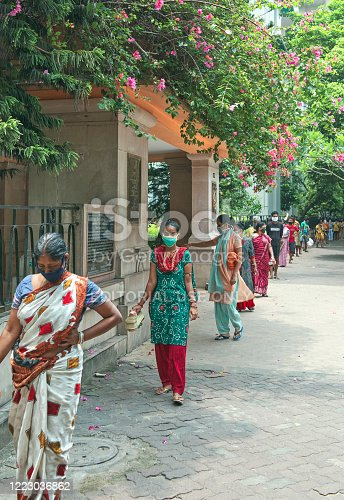 People seen waiting in queue to collect everyday essentials from Ramakrishna Mission Golpark, as part of mission's social & humanitarian work during lockdown in Kolkata.  Photo taken at Ramakrishna Mission Institute of Culture, Golpark, Kolkata on 05/05/2020.