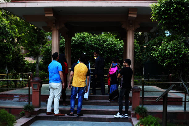 people standing near amar jyoti (timeless light) jallianwala bagh amritsar, india - memorial day weekend stock pictures, royalty-free photos & images