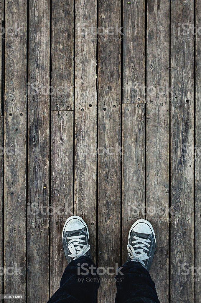 People standing on wooden floor stock photo