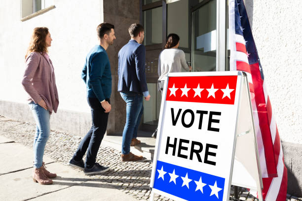 people standing outside voting room - vote sign stock photos and pictures