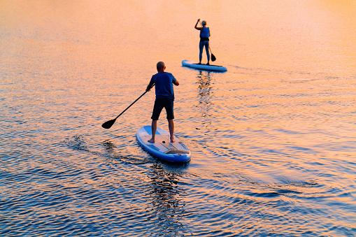 People standing up on Paddle boat on Galve Lake Trakai