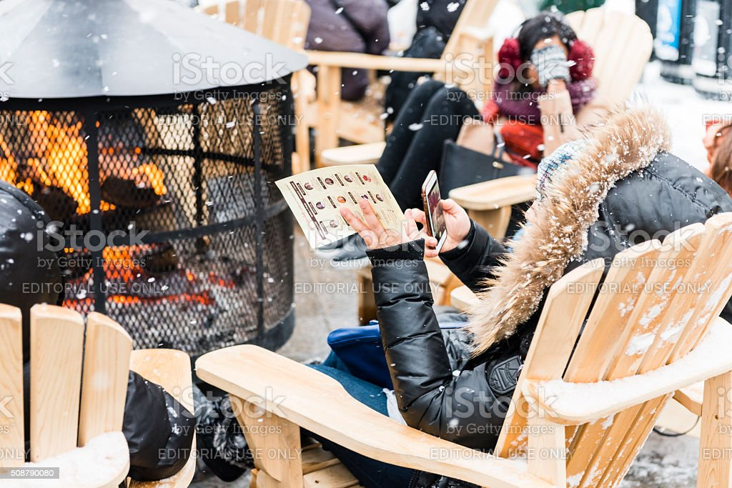 People Stay Warm by Fire Outdoors in Old Montreal Winter stock photo