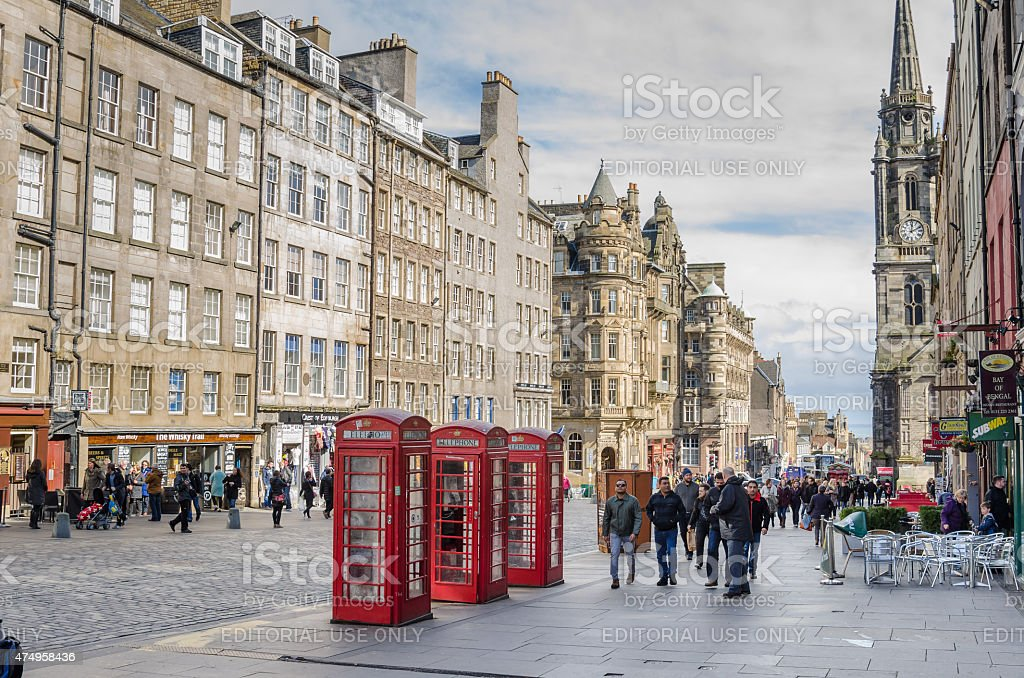 People Strolling along the Royal Mile on a Windy Day stock photo