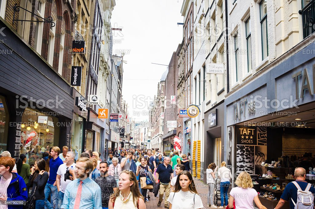 People strooling a round a Shopping Street in Amsterdam stock photo