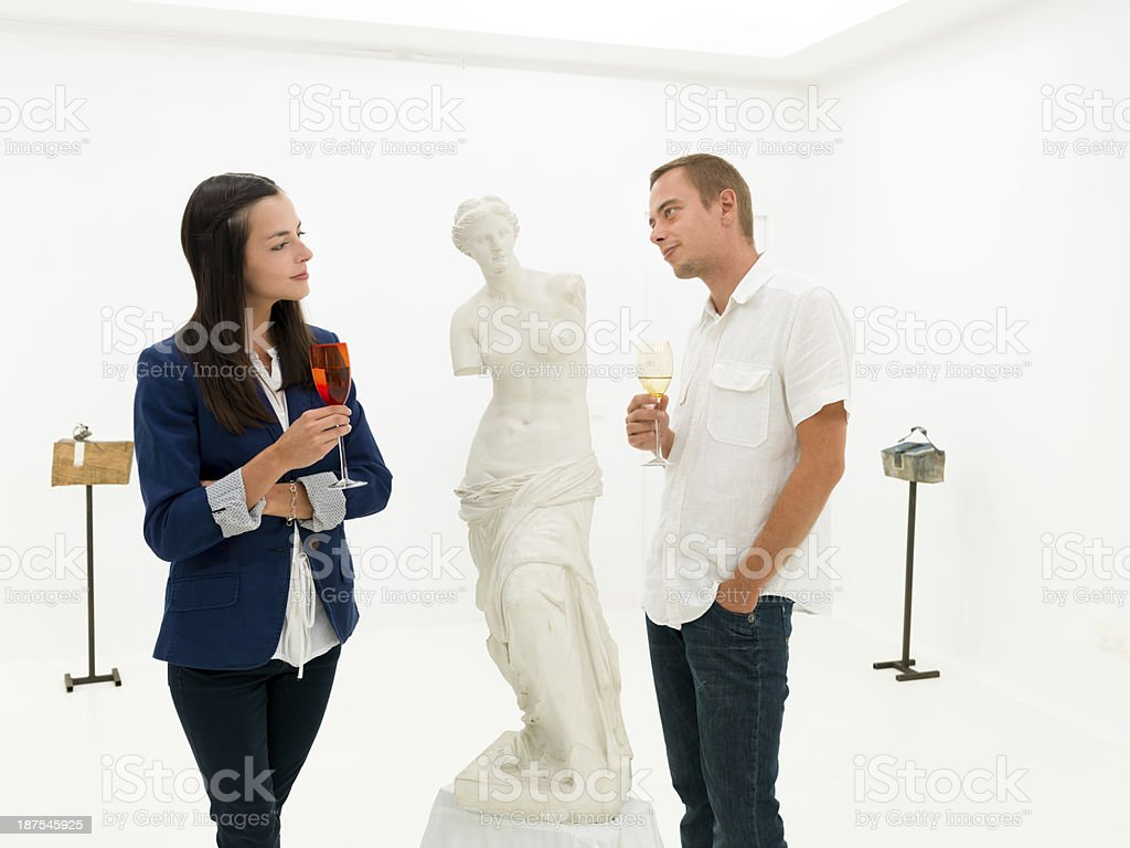 people studying fine art statue in museum stock photo