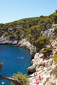 France, People sunbathing and swimming in Massif des Calanques