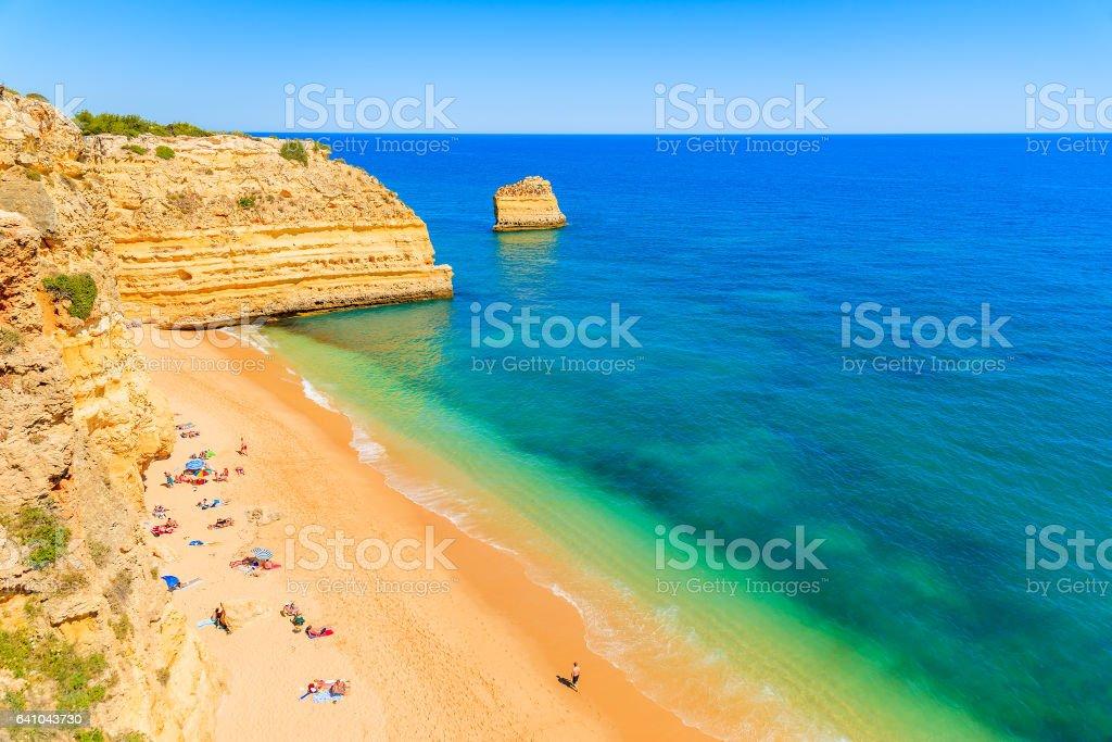 People sunbathing on beautiful Marinha beach, Portugal stock photo