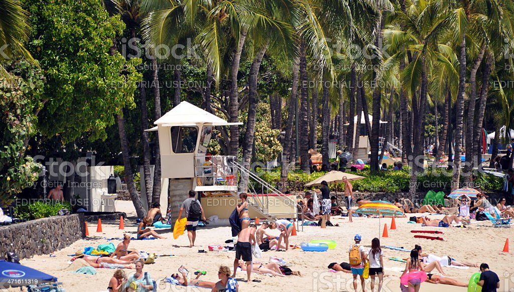 People sunbathing on Waikiki Beach royalty-free stock photo
