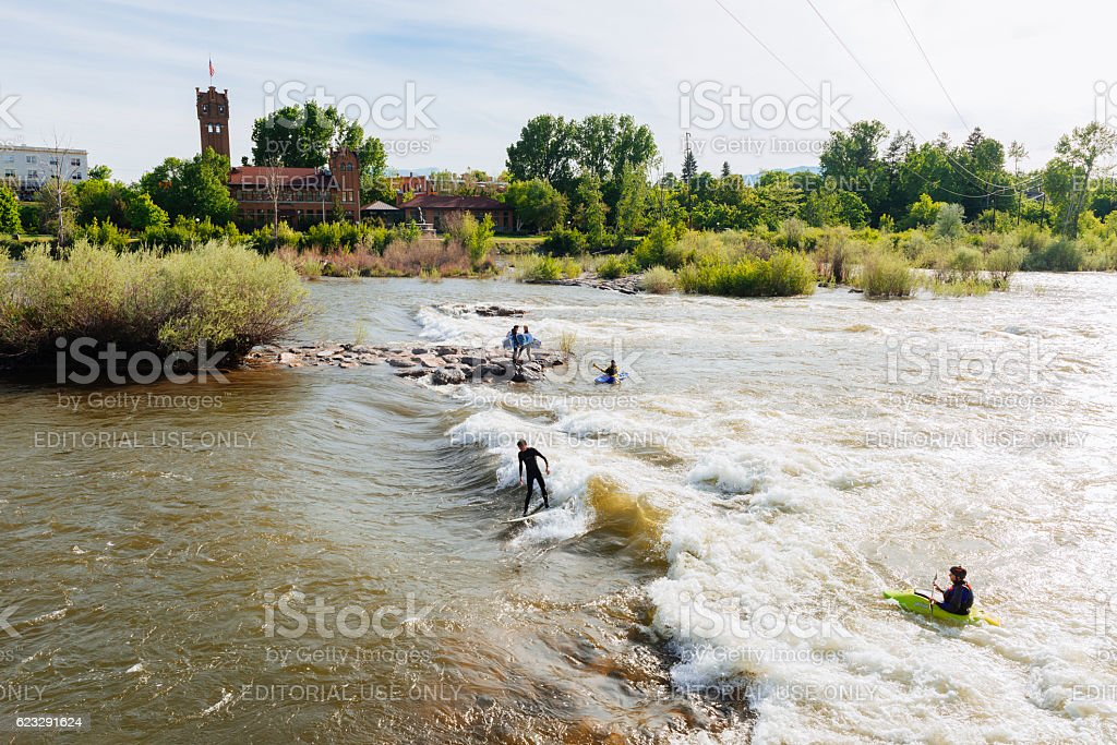 People Surf and Kayak Brennan's Wave in Missoula Montana USA stock photo
