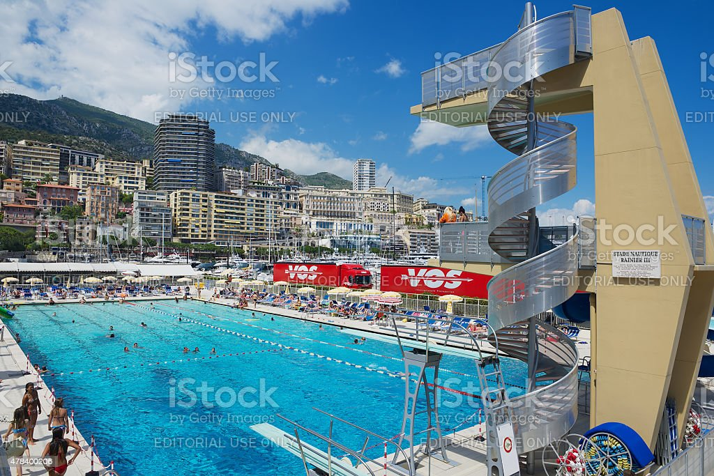 People Swim And Sunbathe At The Public Swimming Pool Monaco Royalty Free Stock