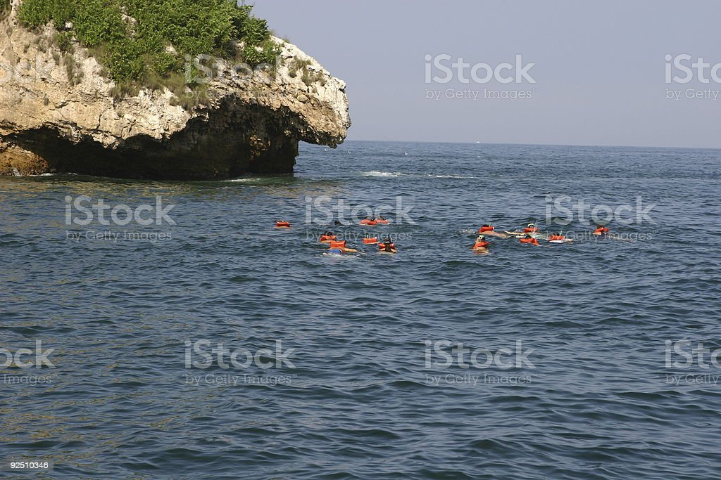people swiming in the ocean royalty-free stock photo