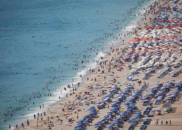 People Swimming And Having Sun Bath In Cleopatra Beach Alanya,Antalya stock photo