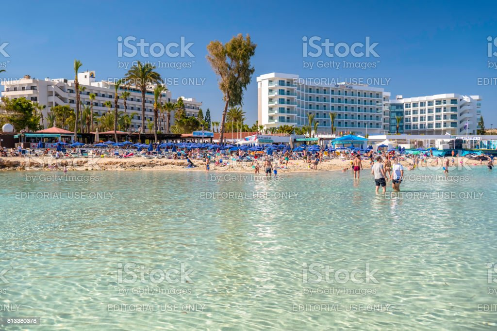 People swimming and sunbathing on the picturesque Nissi beach stock photo