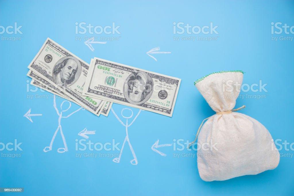 people take money from the big bag zbiór zdjęć royalty-free