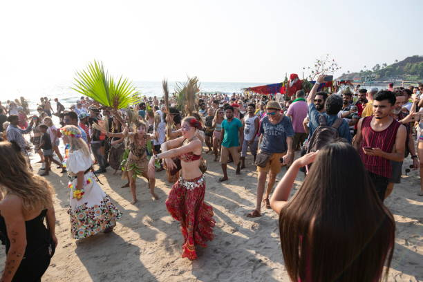 People take part at annual beach carnival in Arambol, Goa, India. stock photo