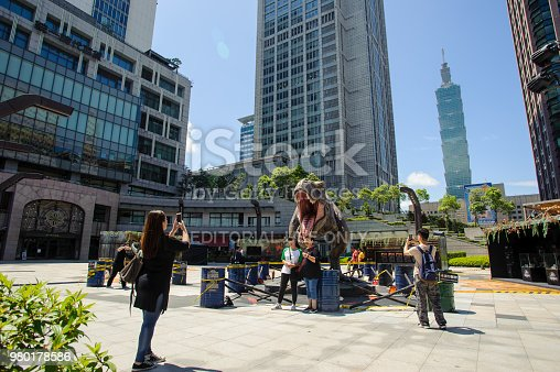 istock People take photo with dinosaur model in Uni-President,Taipei 980178586
