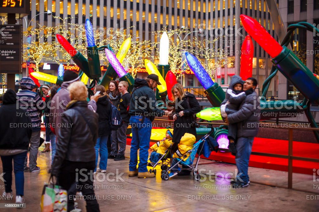 People Take Photos by Colorful Christmas Display Manhattan 2012 royalty-free stock photo
