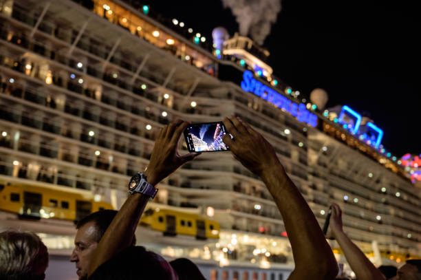 People take pictures of cruise ship
