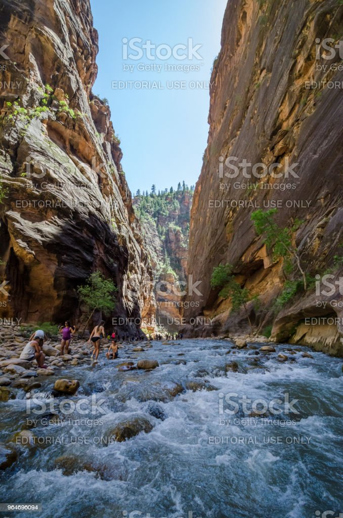 People taking a rest while Hiking The Narrows royalty-free stock photo