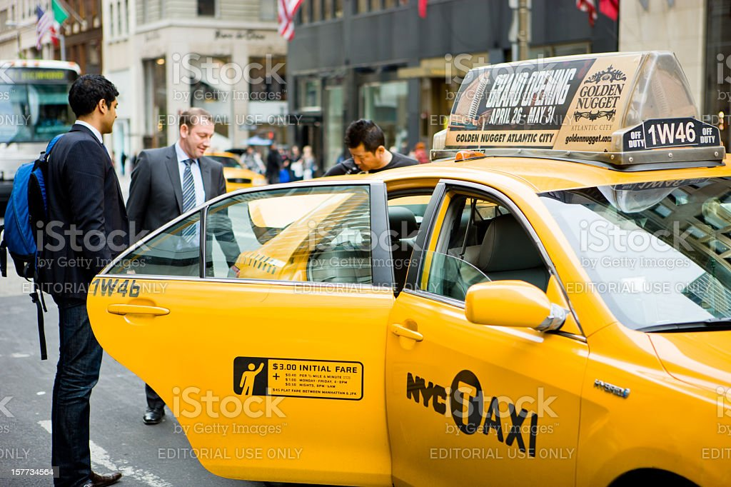 People taking luggage from a taxi, New York, USA royalty-free stock photo