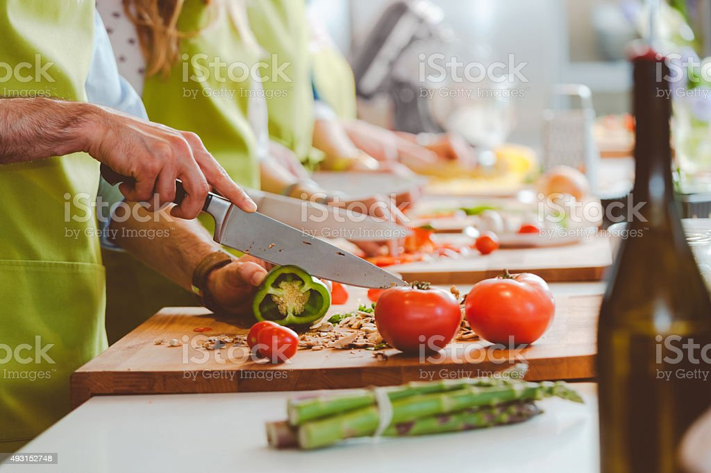 People taking part in cooking class stock photo