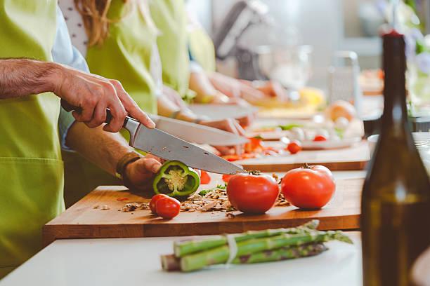 Personnes prenant part à un cours de cuisine - Photo
