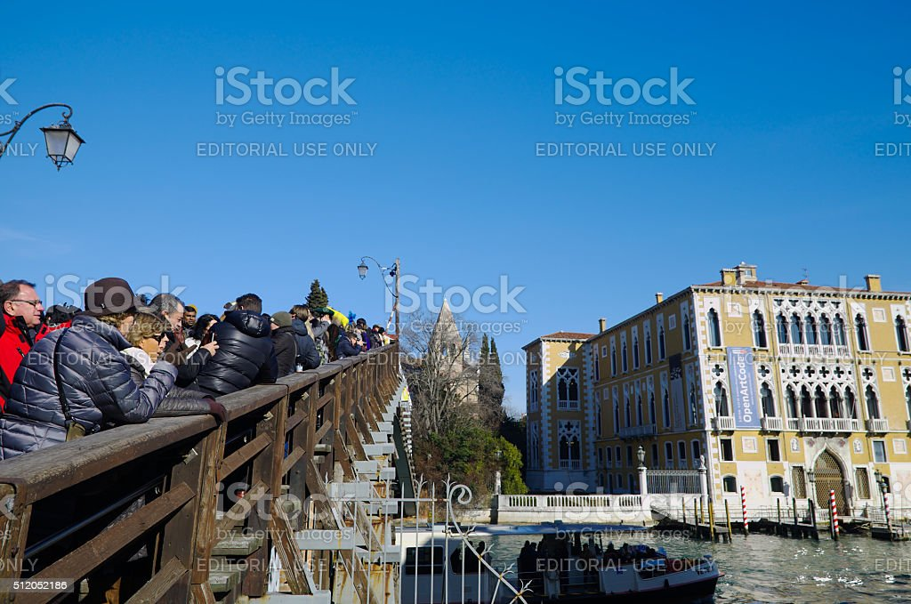 People taking photos from the 'ponte dell'accademia' bridge stock photo