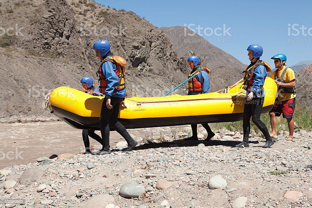 People taking raft to rapids royalty-free stock photo