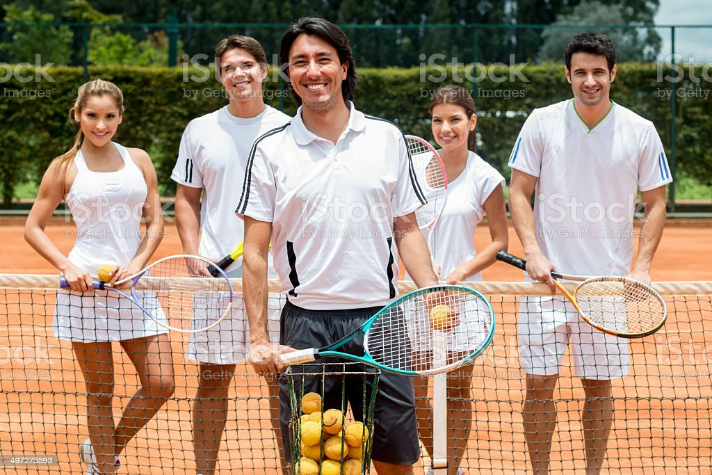 People taking tennis lessons stock photo