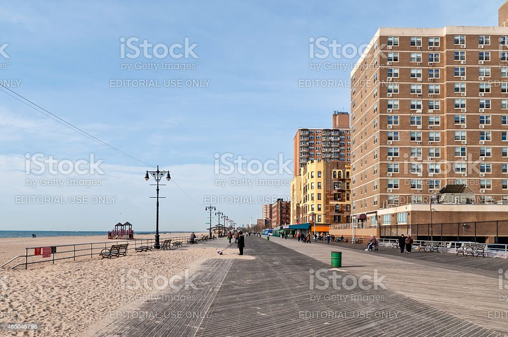 People taking the sun at Brighton Beach in Brooklyn NY stock photo