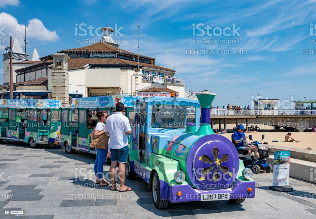 People talk to the driver of the land train in Bournemouth stock photo