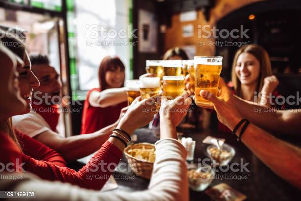 People talking and toasting in a pub with the beers picture id1091469178?b=1&k=6&m=1091469178&s=612x612&h=kangah5jo8jdde9vgb7oqogen1g333tnmhsbwsqwdew=