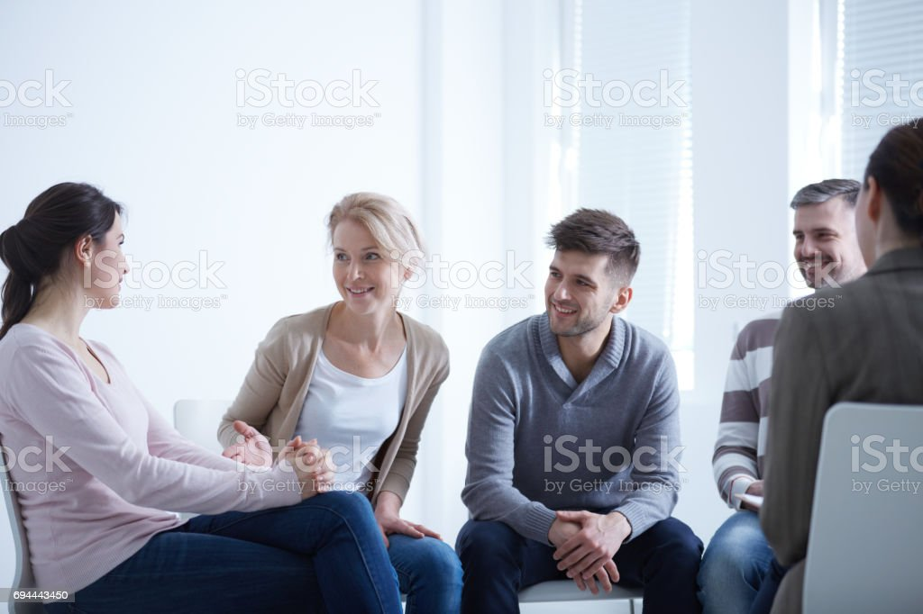 People talking in circle stock photo